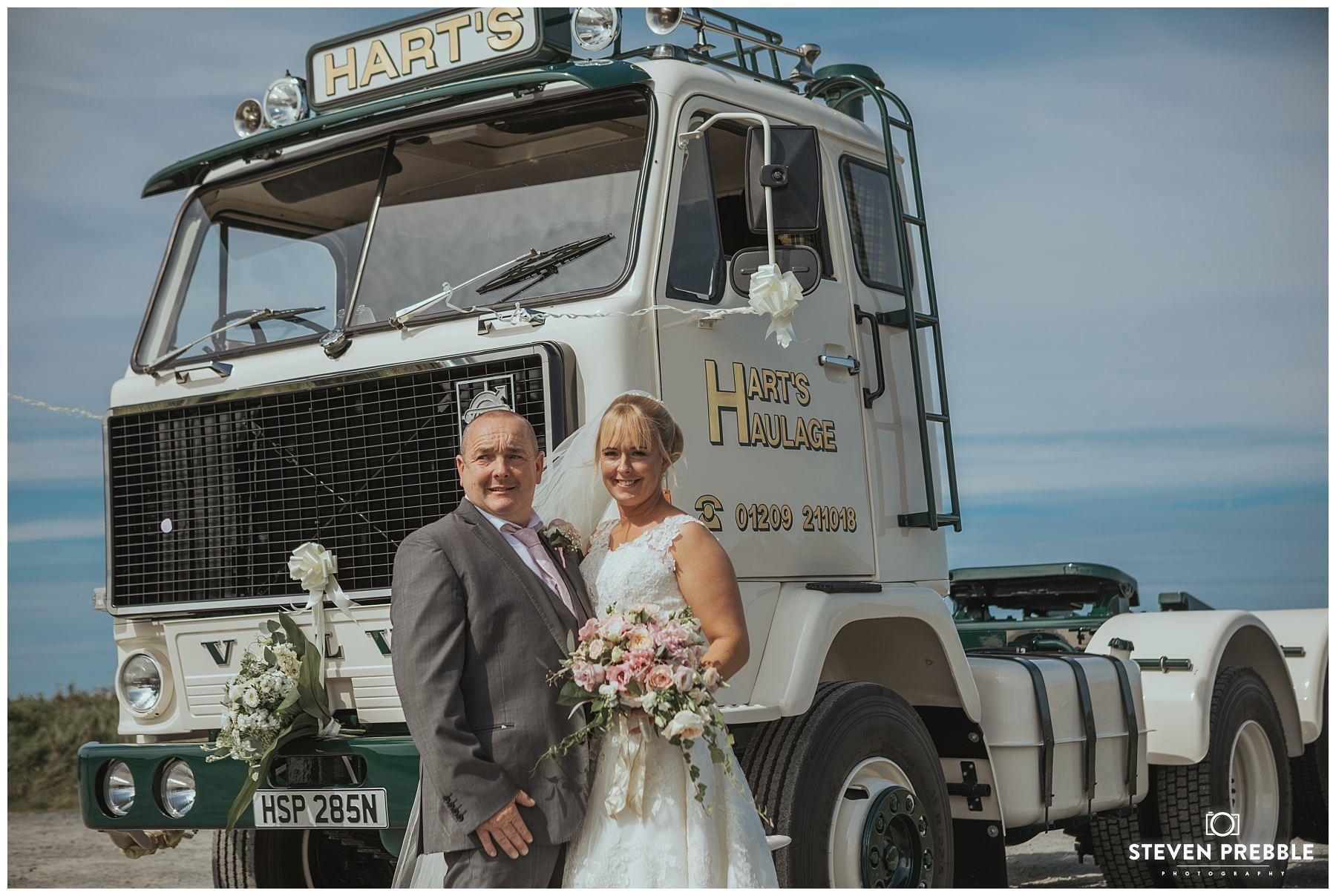 Wedding couple pose infront of truck Cornwall