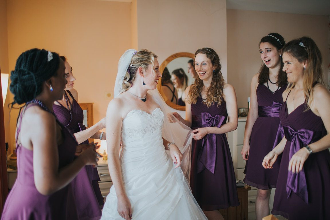 Dress shown to purple bridesmaid dress wedding photography