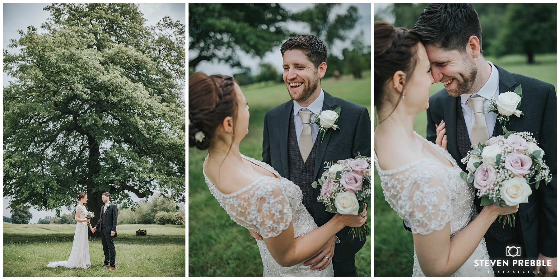 Bride and groom pose beneath tree in reading