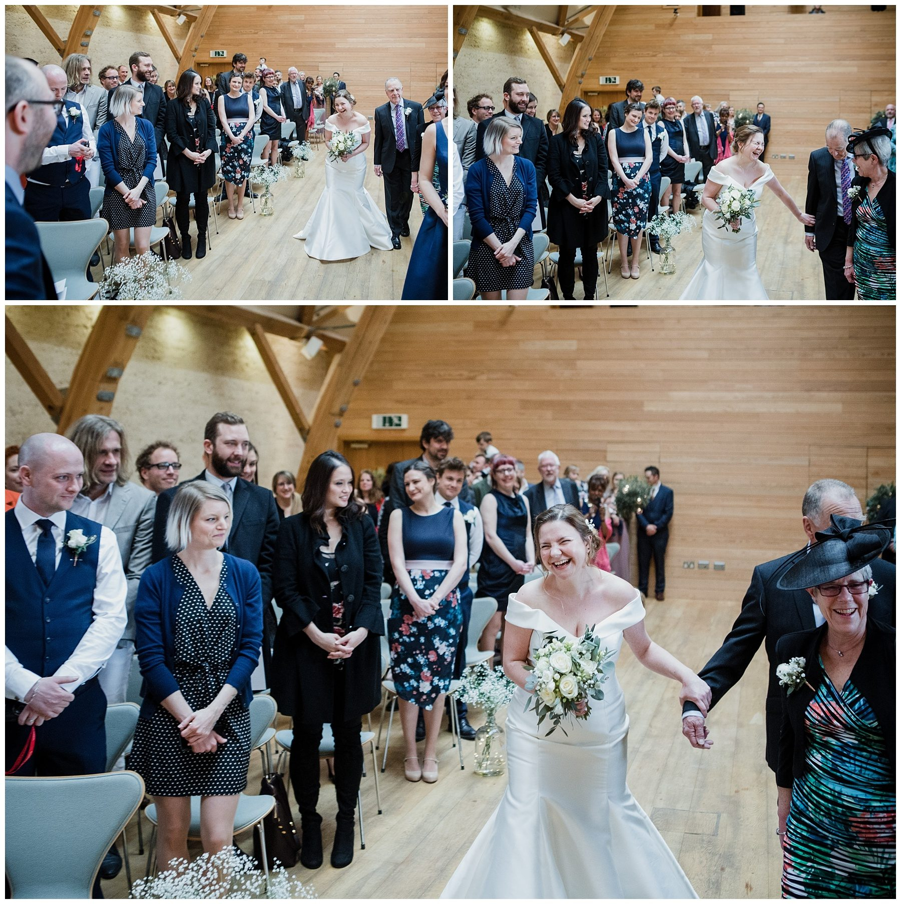 Bride laughing as walking down the isle