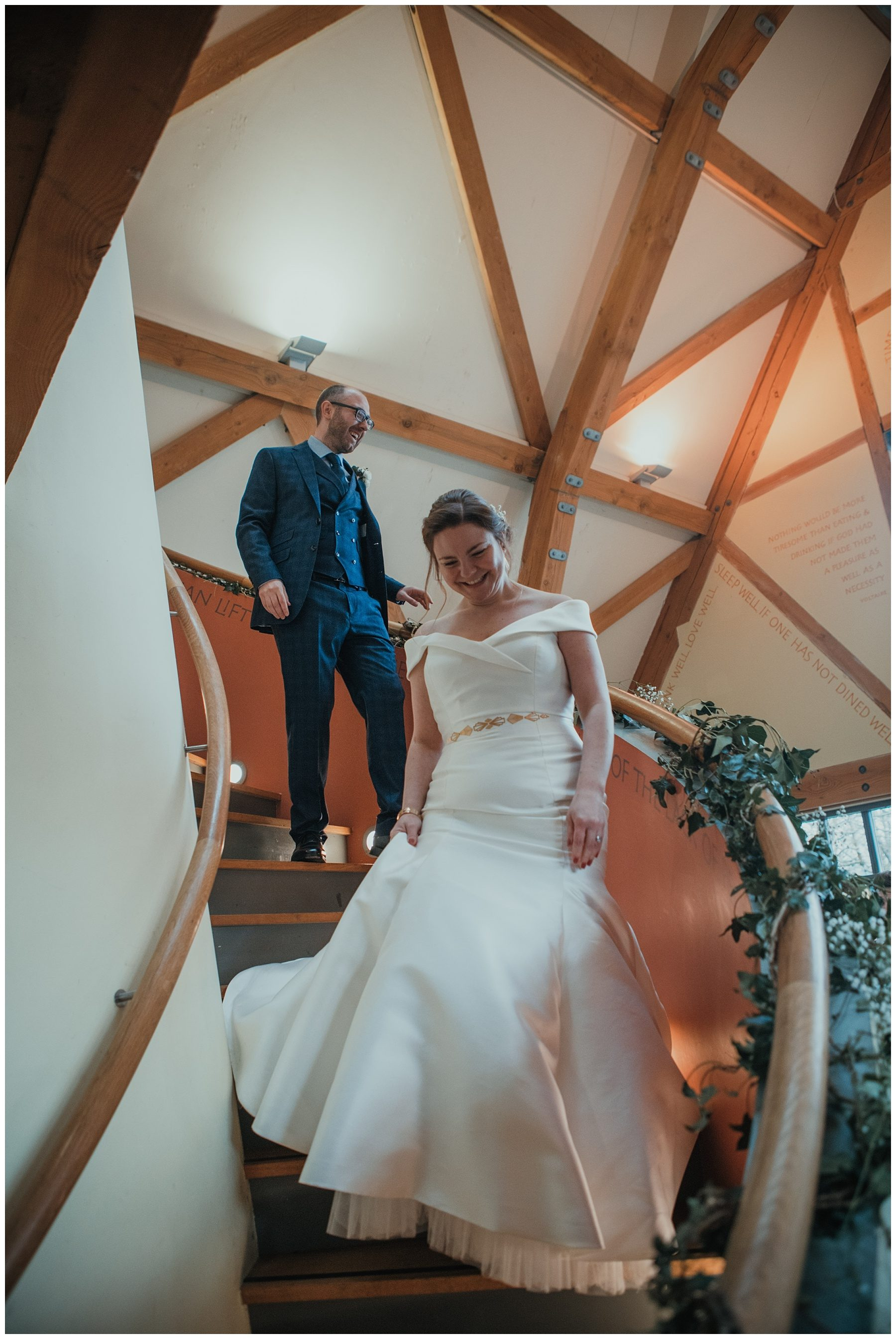 Bride walking down spiral staircase