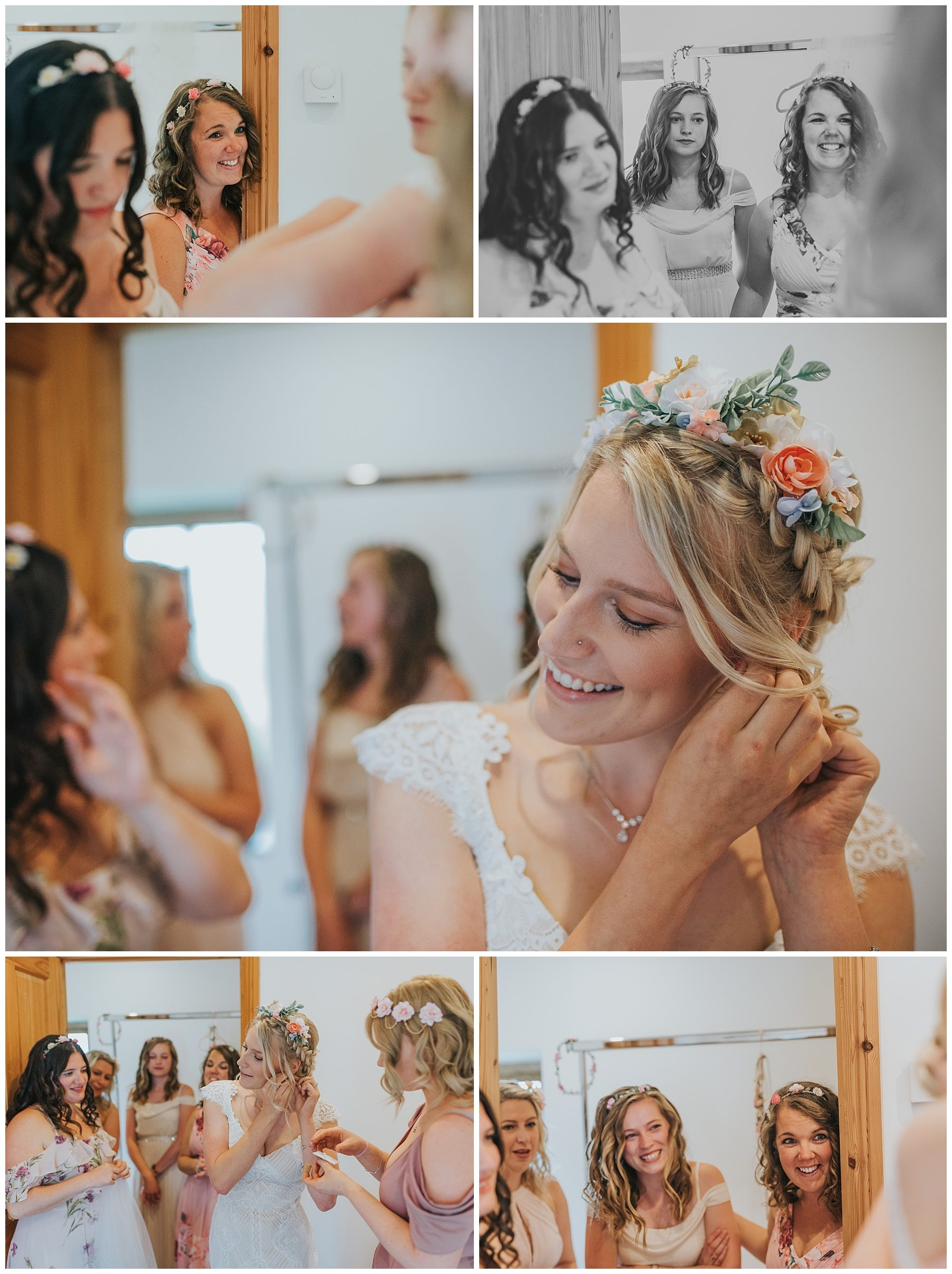 Bride putting on dress with bridesmaids watching