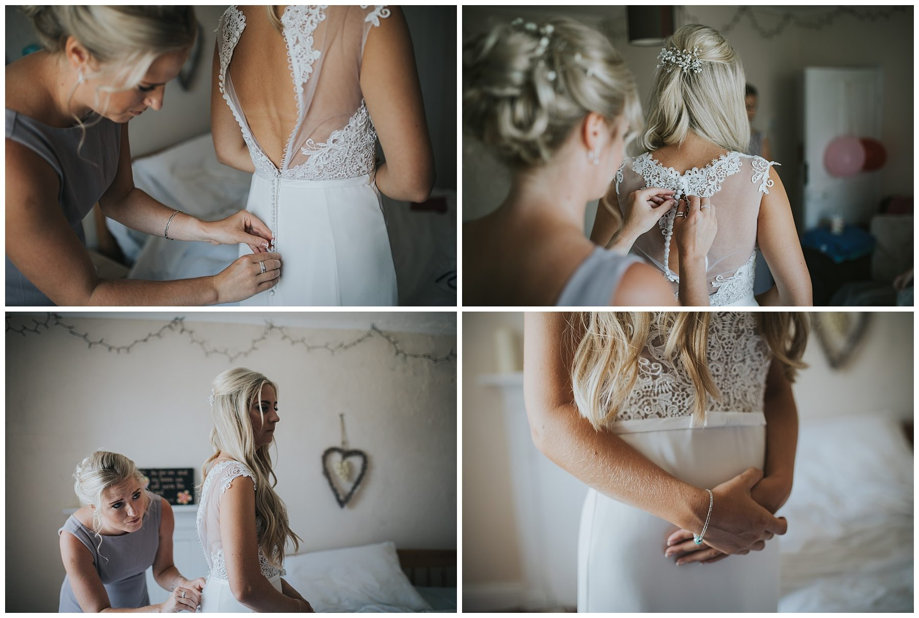 Bride getting lace dress put on