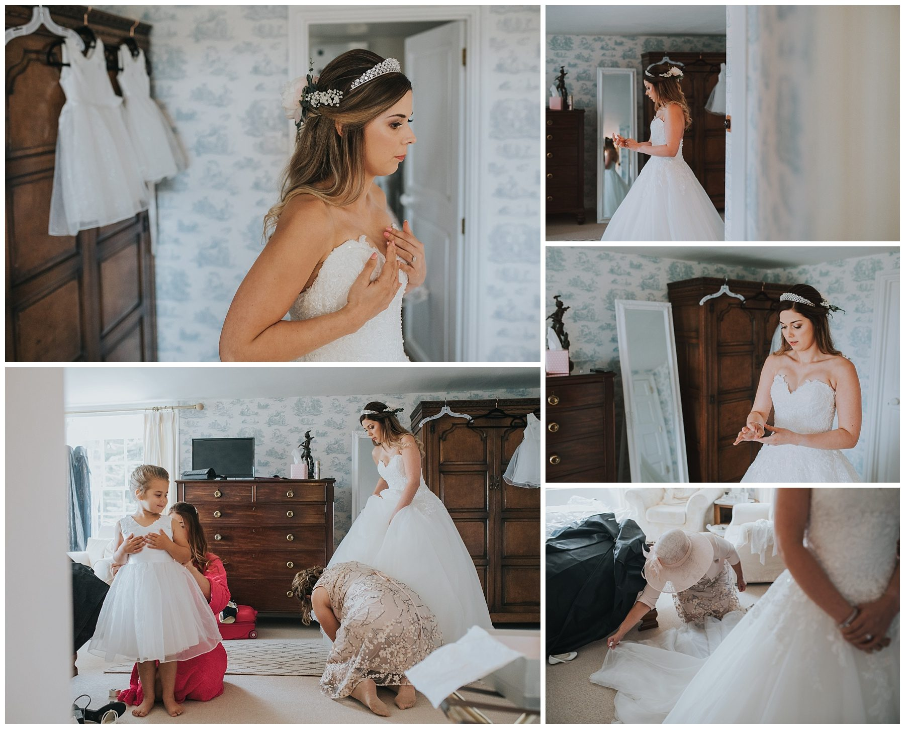 Cornwall wedding photography bride putting on dress
