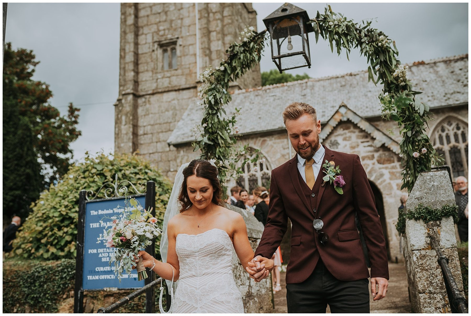 Bride and groom leaving church wedding photographer cornwall