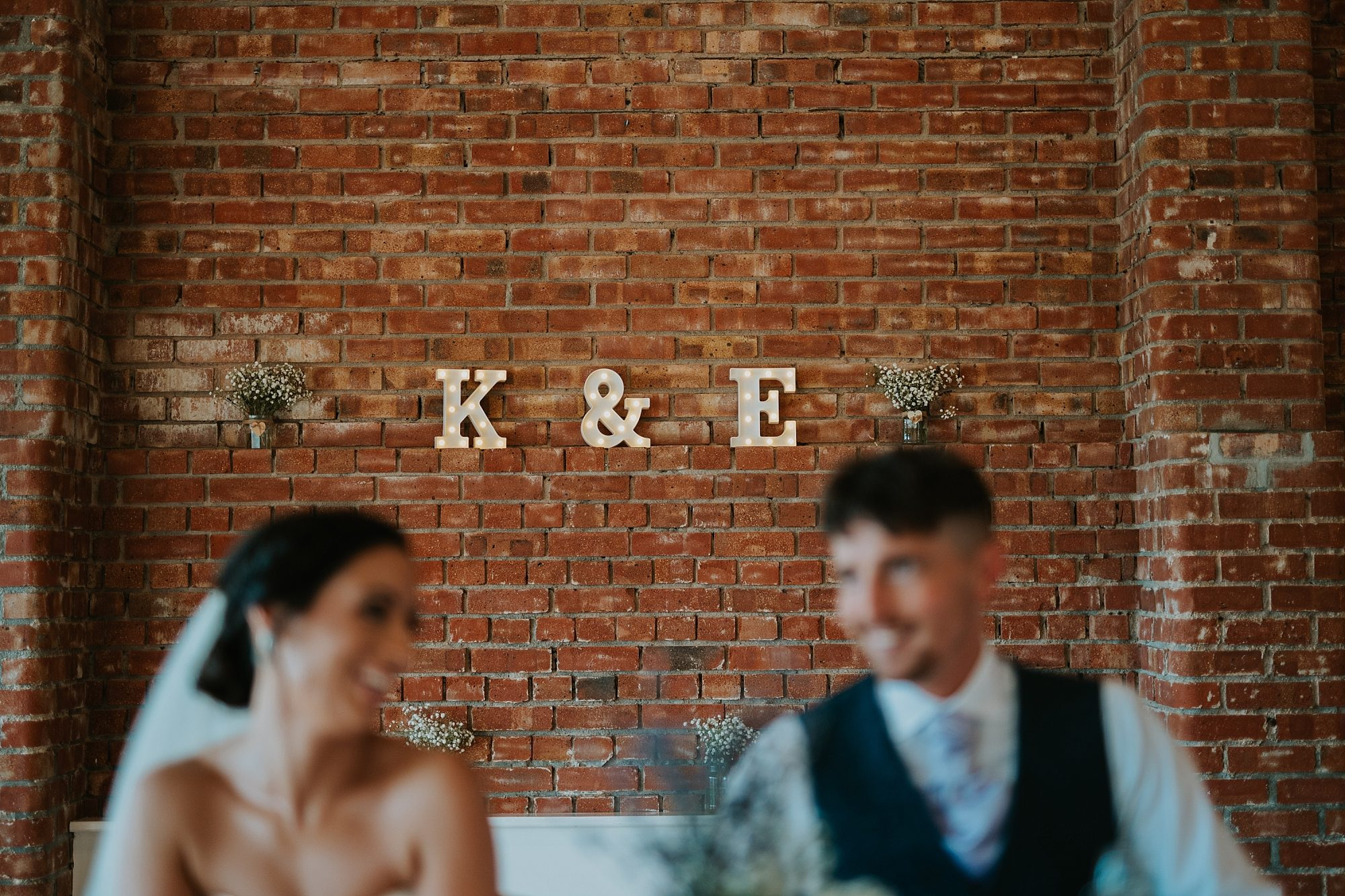Love letters on red brick wall at wedding